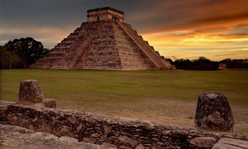 The Kukulkan Pyramid at Chichen Itza was a terraced monument as opposed to being a true pyramid form such as we see in Egypt. There were clear reasons for this departure from Egyptian architectural practice because in the West, pyramids convey specific numbers which can enable us to see why they were built where they were upon the earth. This is how you decode the longitude of this structure. (Based on the Great Pyramid at Giza, Egypt being at longitude zero.) 9 terraces x 365 steps x 4 sides x 4 stairways = 52,560 The structure's longitude (based on Giza) is 119 degrees west, 42 minutes and 10.51620648 seconds. Those numbers multiply out to 52559.99998704 A coincidence? Or did they somehow know exactly where this structure was located in relation to Giza. One of the world's most puzzling mysteries I suppose! (Well, it is an imagined coincidence I suppose...lol..) This structure was built by the Toltecs around 1200ad. The Mayans were driven out after building structures here for about 600 years. Today, the Mayans are the main group of people living in this area.